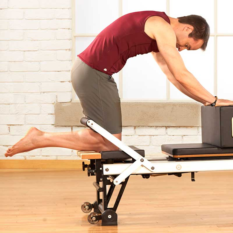 Man on pilates reformer
